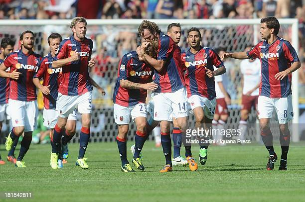 Cesare Natali of Bologna FC celebrates with his teamates after scoring a goal during the Serie A match between Bologna FC and Torino FC at Stadio...