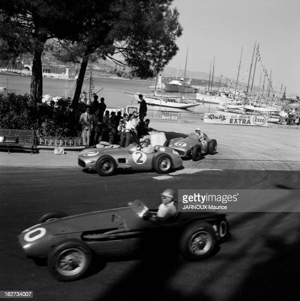 Cesare Perdisa driving the Maserati 250F moves over to allow Juan Manuel Fangio driving the MercedesBenz W196 and his team mate Stirling Moss in the...