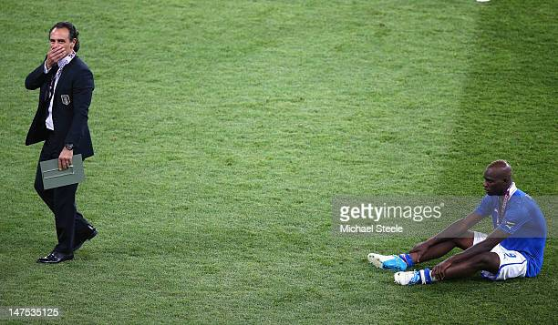 Cesare Prandelli coach of Italy is distraught alongside Mario Balotelli after the 0-4 defeat during the UEFA EURO 2012 final match between Spain and...
