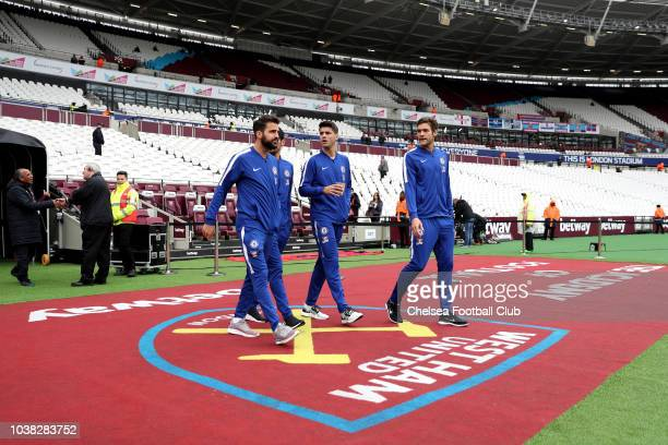 Cesc Fabregas Alvaro Morata and Marcos Alonso of Chelsea walk out to inspect the pitch prior to the Premier League match between West Ham United and...
