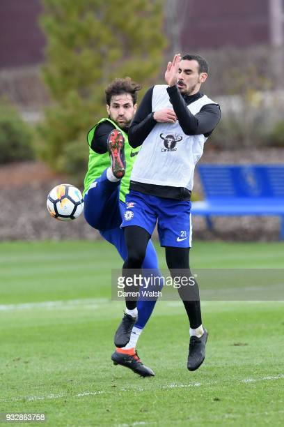 Cesc Fabregas and Davide Zappacosta of Chelsea during a training session at Chelsea Training Ground on March 16 2018 in Cobham United Kingdom