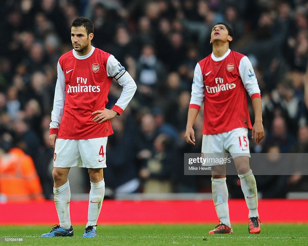 Cesc Fabregas and Denilson of Arsenal react to Tottenham's winning goal during the Barclays Premier League match between Arsenal and Tottenham Hotspur at the Emirates Stadium on November 20, 2010 in London, England.