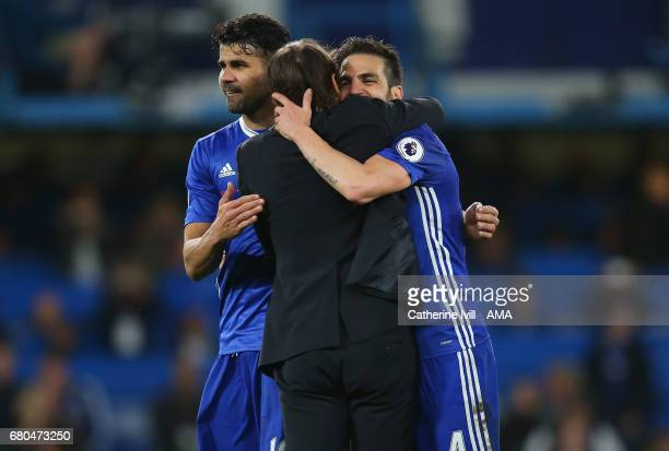 Cesc Fabregas and Diego Costa of Chelsea hug Antonio Conte manager of Chelsea after the Premier League match between Chelsea and Middlesbrough at...