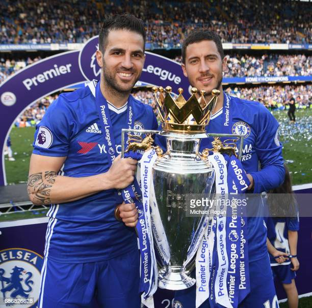 Cesc Fabregas and Eden Hazard of Chelsea pose with the Premier League trophy after the Premier League match between Chelsea and Sunderland at...