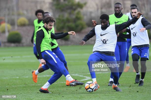 Cesc Fabregas and Joseph Colley of Chelsea during a training session at Chelsea Training Ground on March 16 2018 in Cobham United Kingdom