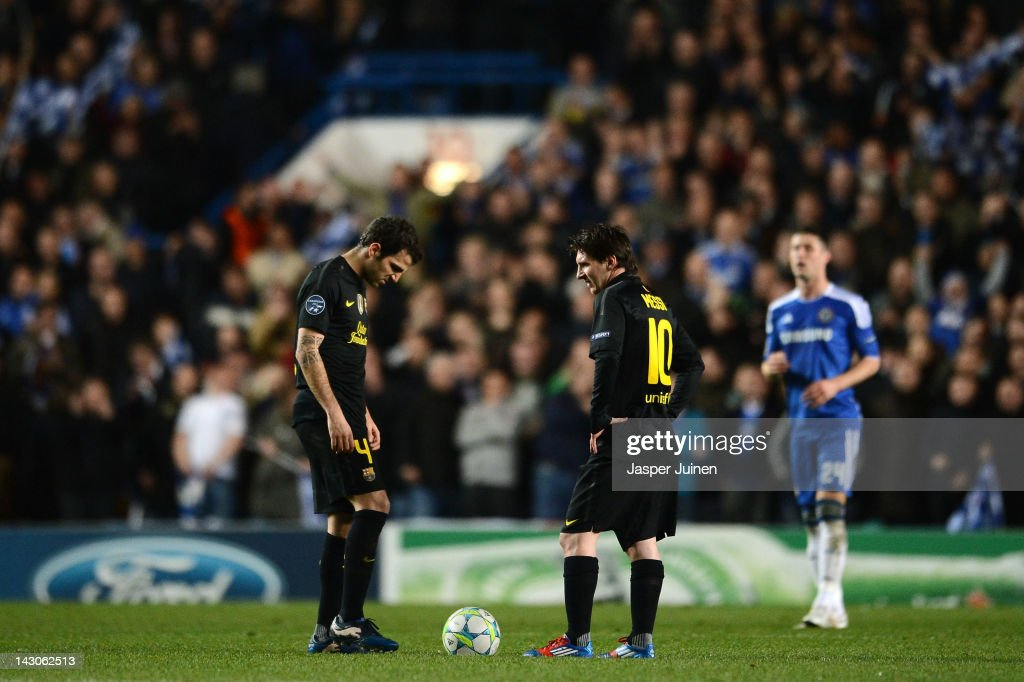 Cesc Fabregas (L) and Lionel Messi of Barcelona look dejected after the Chelsea goal during the UEFA Champions League Semi Final first leg match between Chelsea and Barcelona at Stamford Bridge on April 18, 2012 in London, England.