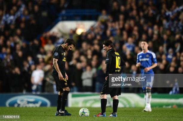 Cesc Fabregas and Lionel Messi of Barcelona look dejected after the Chelsea goal during the UEFA Champions League Semi Final first leg match between...