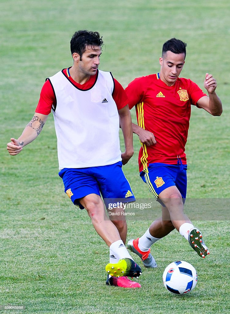 Cesc Fabregas (L) and Lucas Vazquez of Spain in action during a training session on June 9, 2016 in La Rochelle, France.