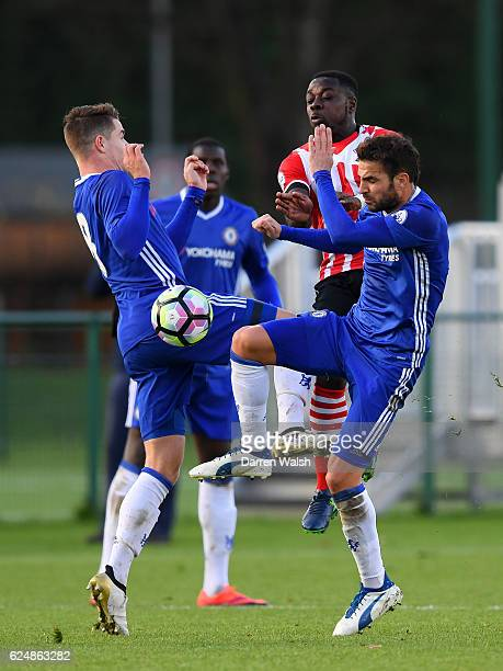 Cesc Fabregas and Marco van Ginkel of Chelsea battle for the ball with Olufela Olomola of Southampton during the Premier League 2 match between...