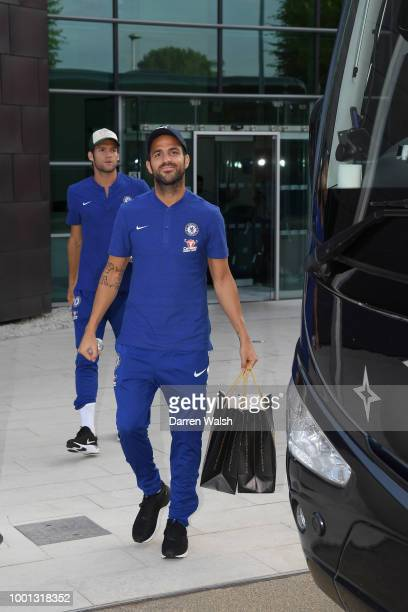 Cesc Fabregas and Marcos Alonso of Chelsea leave Cobham to travel to the airport to fly to Perth at Chelsea Training Ground on July 18 2018 in Cobham...