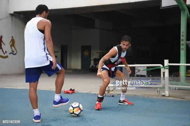 Cesc Fabregas and Pedro of Chelsea during a training session at the AOTI Stadium on July 20 2017 in Beijing China