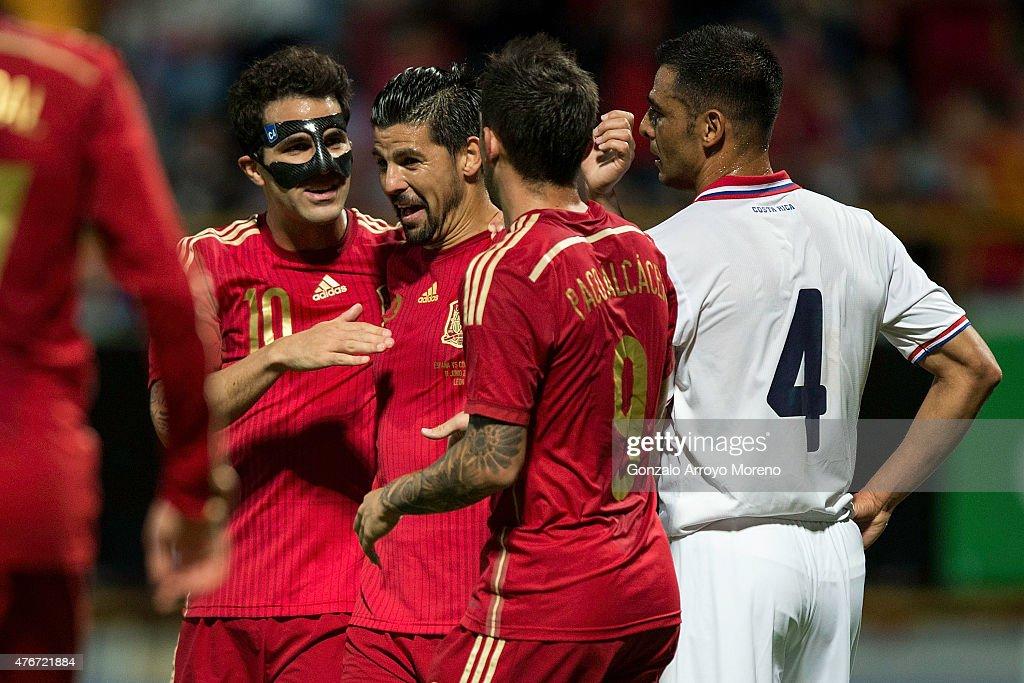 Cesc Fabregas (L) celebrates scoring their second goal with teammateManuel Duran alias Nolito (2ndL) during the international friendly match between Spain and Costa Rica at Reino de Leon Stadium on June 11, 2015 in Leon, Spain.