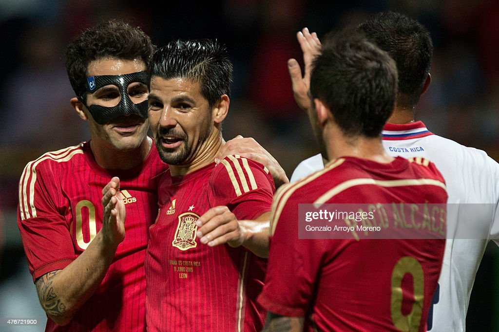 Cesc Fabregas (L) celebrates scoring their second goal with teammate Manuel Duran during the international friendly match between Spain and Costa Rica at Reino de Leon Stadium on June 11, 2015 in Leon, Spain.