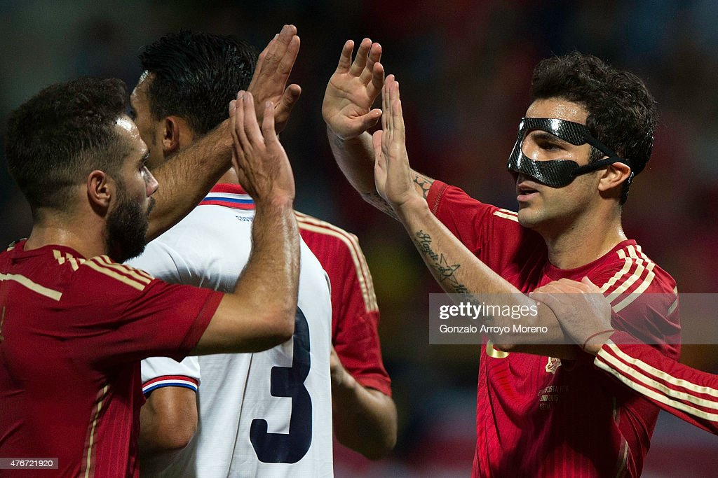 Cesc Fabregas (R) celebrates scoring their second goal with teammate Daniel Carvajal (L) alias Nolito (2ndL) during the international friendly match between Spain and Costa Rica at Reino de Leon Stadium on June 11, 2015 in Leon, Spain.