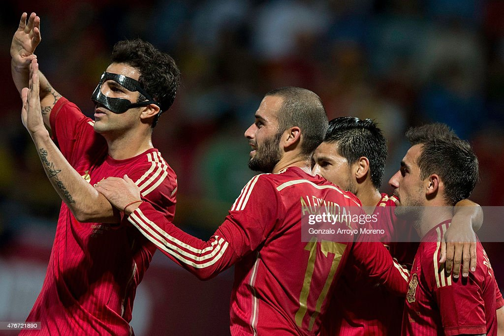 Cesc Fabregas (L) celebrates scoring their second goal with teammates during the international friendly match between Spain and Costa Rica at Reino de Leon Stadium on June 11, 2015 in Leon, Spain.