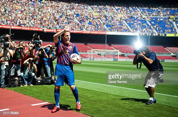 Cesc Fabregas gestures during his presentation as the new signing for FC Barcelona at Camp Nou sports complex on August 15 2011 in Barcelona Spain