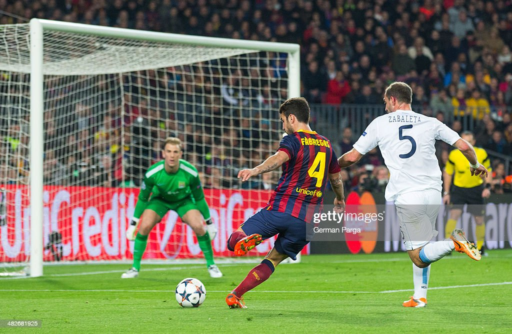 Cesc Fabregas kicks the ball during the UEFA Champions League Round of 16 second leg between FC Barcelona and Manchester City at Camp Nou on March 12, 2014 in Barcelona, Spain.