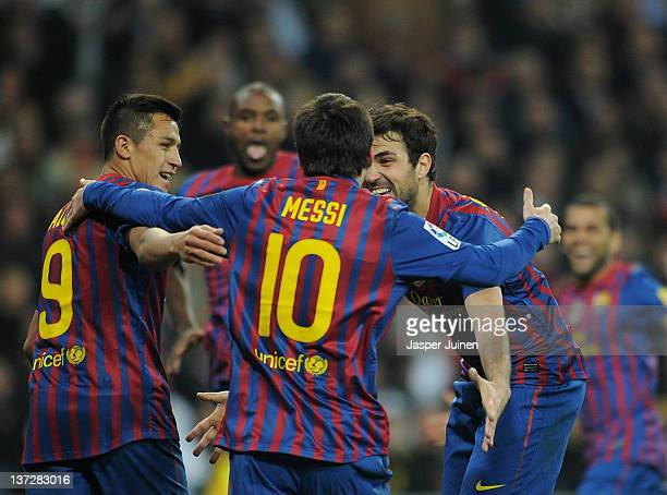 Cesc Fabregas Lionel Messi and Alexis Sanchez of FC Barcelona celebrate the goal of their teammate Eric Abidal during the Copa del Rey quarter final...