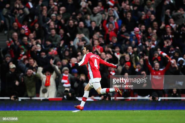 Cesc Fabregas of Arsenal celebrates after he scores a free kick during the Barclays Premier League match between Arsenal and Aston Villa at the...
