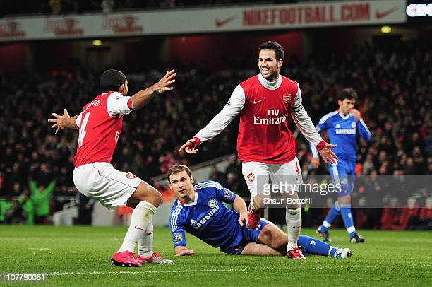 Cesc Fabregas of Arsenal celebrates Arsenal's second goal with Theo Walcott during the Barclays Premier League match between Arsenal and Chelsea at...