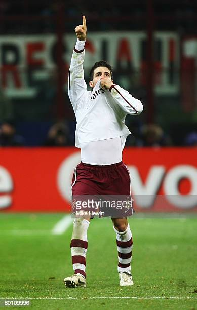 Cesc Fabregas of Arsenal celebrates his teams opening goal during the UEFA Champions League 1st knockout round 2nd leg match between AC Milan and...