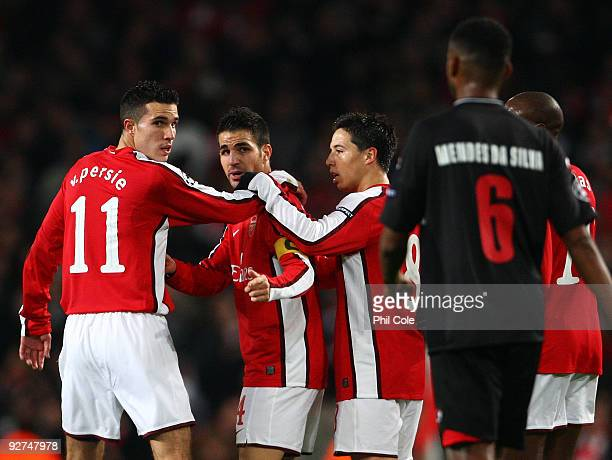 Cesc Fabregas of Arsenal celebrates scoring the first goal of the game while looking at David Mendes Da Silva of AZ Alkmaar during the UEFA Champions...