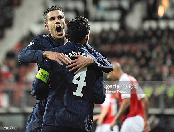 Cesc Fabregas of Arsenal celebrates with Robin van Persie after scoring the first goal during the UEFA Champions League Group H match between AZ...