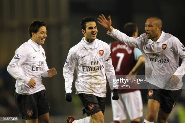 Cesc Fabregas of Arsenal celebrates with Samir Nasri and Mikael Silvestre after scoring the opening goal during the Barclays Premier League match...