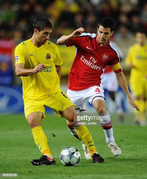 Cesc Fabregas of Arsenal challenges Sebastian Eguren of Villarreal during the UEFA Champions League quarterfinal first leg match between Villarreal...