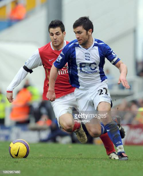 Cesc Fabregas of Arsenal competes with Damien Johnson of Birmingham during the Barclays Premier League match between Birmingham City and Arsenal at...
