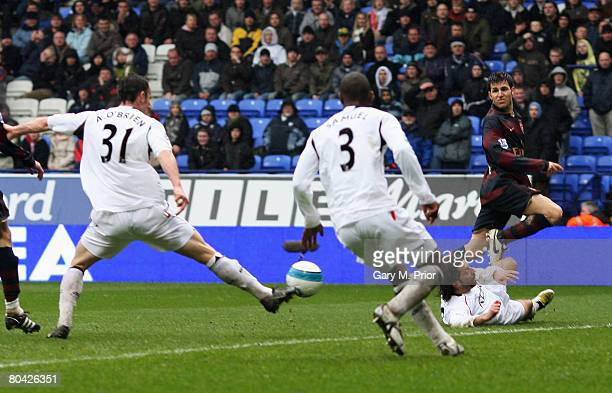 Cesc Fabregas of Arsenal crosses moments before Jlloyd Samuel of Bolton scores an own goal during the Barclays Premiership match between Bolton...