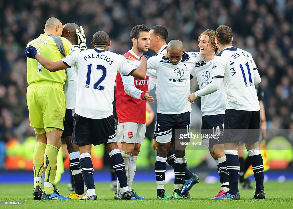 Cesc Fabregas of Arsenal finds himself in the middle of Tottenham celebrations after the Barclays Premier League match between Arsenal and Tottenham Hotspur at the Emirates Stadium on November 20, 2010 in London, England.