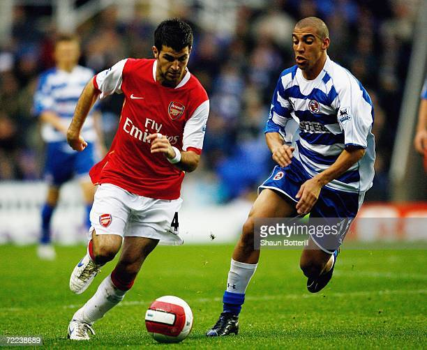 Cesc Fabregas of Arsenal goes past James Harper of Reading during the Barclays Premiership match between Reading and Arsenal at the Madejski Stadium...