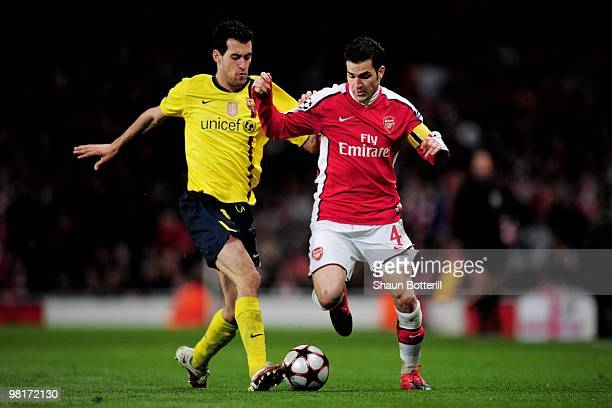 Cesc Fabregas of Arsenal is tackled by Sergio Busquets of Barcelona during the UEFA Champions League quarter final first leg match between Arsenal...
