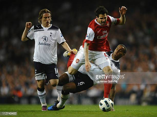 Cesc Fabregas of Arsenal is tackled by Tom Huddlestone of Spurs during the Barclays Premier League match between Tottenham Hotspur and Arsenal at...