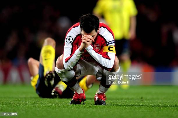Cesc Fabregas of Arsenal reacts after being shown a yellow card by referee Massimo Busacca of Switerland during the UEFA Champions League quarter...