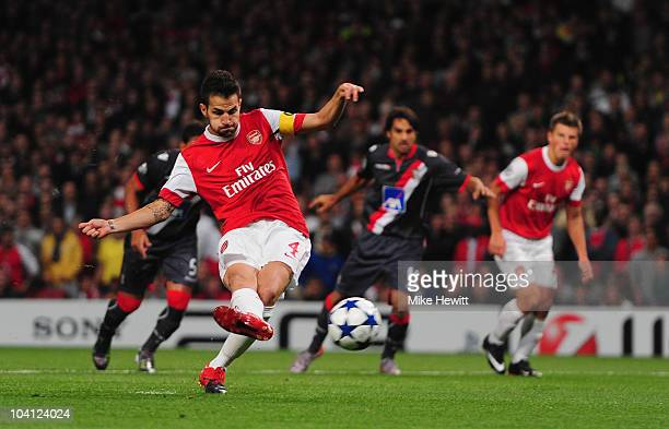 Cesc Fabregas of Arsenal scores from the penalty spot during the UEFA Champions League Group H match between Arsenal and SC Braga at the Emirates...