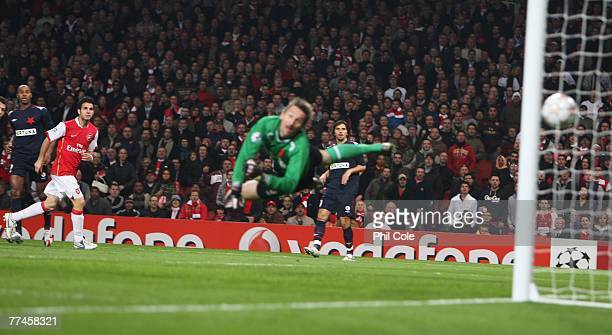 Cesc Fabregas of Arsenal scores the opening goal during the UEFA Champions League Group H match between Arsenal and Slavia Prague at the Emirates...