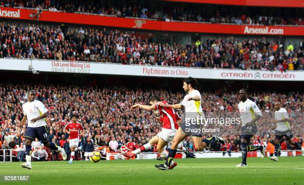 Cesc Fabregas of Arsenal scores the second goal during the Barclays Premier League match between Arsenal and Tottenham Hotspur at the Emirates...