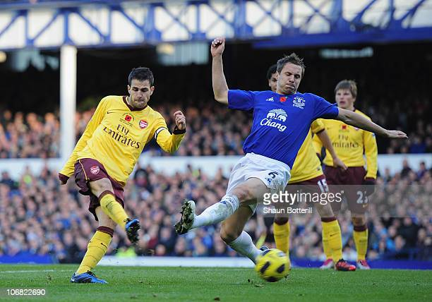 Cesc Fabregas of Arsenal shoots past Phil Jagielka of Everton to score the 20 goal during the Barclays Premier League match between Everton and...