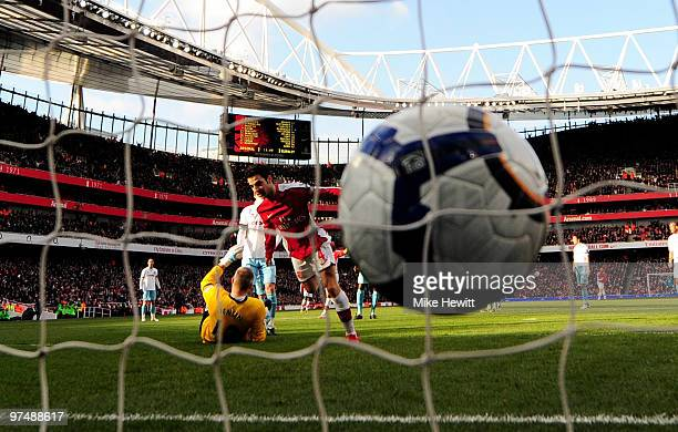 Cesc Fabregas of Arsenal slots the ball under Brian Jensen of Burnley to score during the Barclays Premier League match between Arsenal and Burnley...