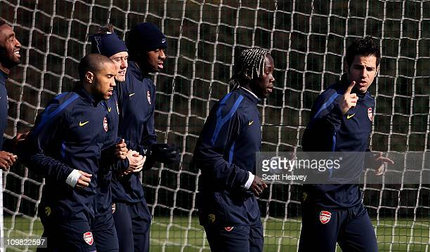 Cesc Fabregas of Arsenal talks to teammates during a training session ahead of the UEFA Champions League Round of 16 second leg match against...
