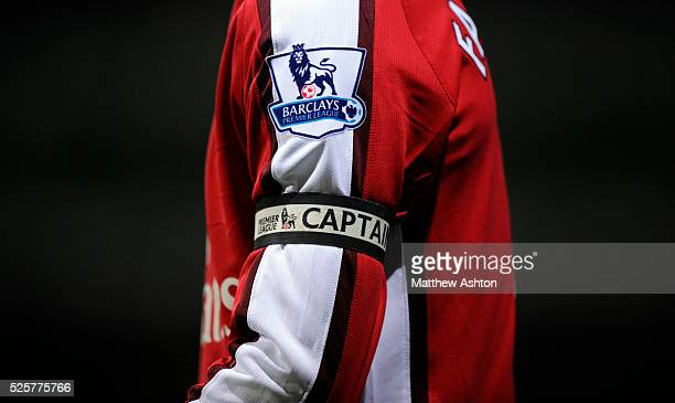 Cesc Fabregas of Arsenal wearing his captains armband with a Barclays Premier League logo / badge | Location Bolton England United Kingdom