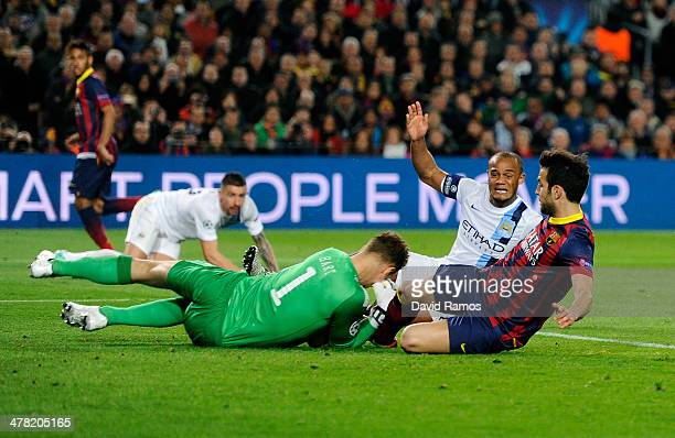 Cesc Fabregas of Barcelona slides in on goalkeeper Joe Hart of Manchester City during the UEFA Champions League Round of 16, second leg match between...