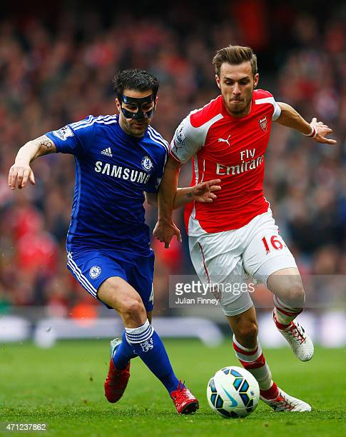 Cesc Fabregas of Chelsea and Aaron Ramsey of Arsenal battle for the ball during the Barclays Premier League match between Arsenal and Chelsea at...