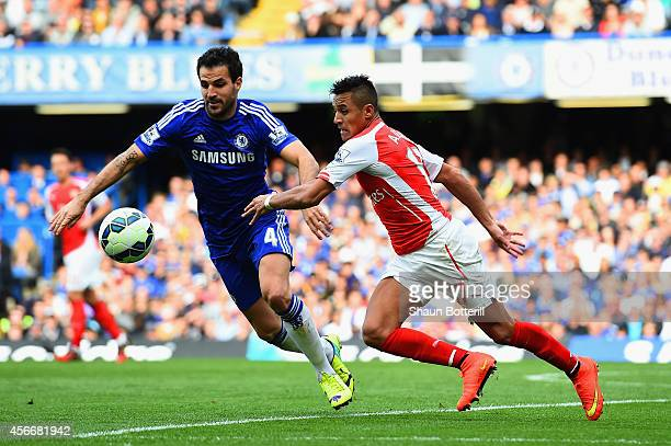 Cesc Fabregas of Chelsea and Alexis Sanchez of Arsenal battle for the ball during the Barclays Premier League match between Chelsea and Arsenal at...
