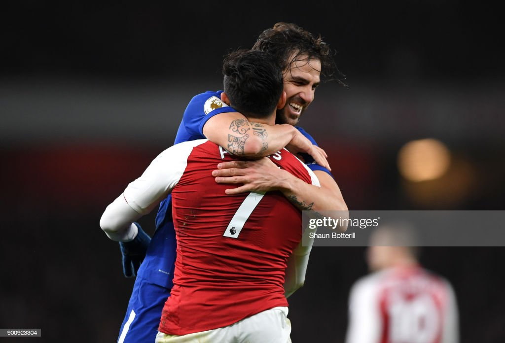 Cesc Fabregas of Chelsea and Alexis Sanchez of Arsenal react during the Premier League match between Arsenal and Chelsea at Emirates Stadium on January 3, 2018 in London, England.
