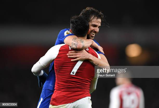 Cesc Fabregas of Chelsea and Alexis Sanchez of Arsenal react during the Premier League match between Arsenal and Chelsea at Emirates Stadium on...