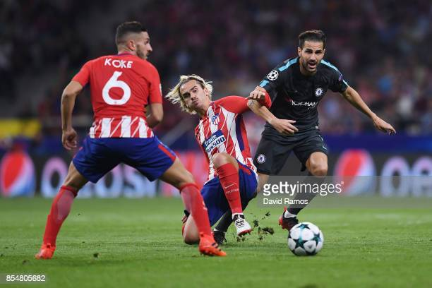 Cesc Fabregas of Chelsea and Antoine Griezmann of Atletico Madrid in action during the UEFA Champions League group C match between Atletico Madrid...