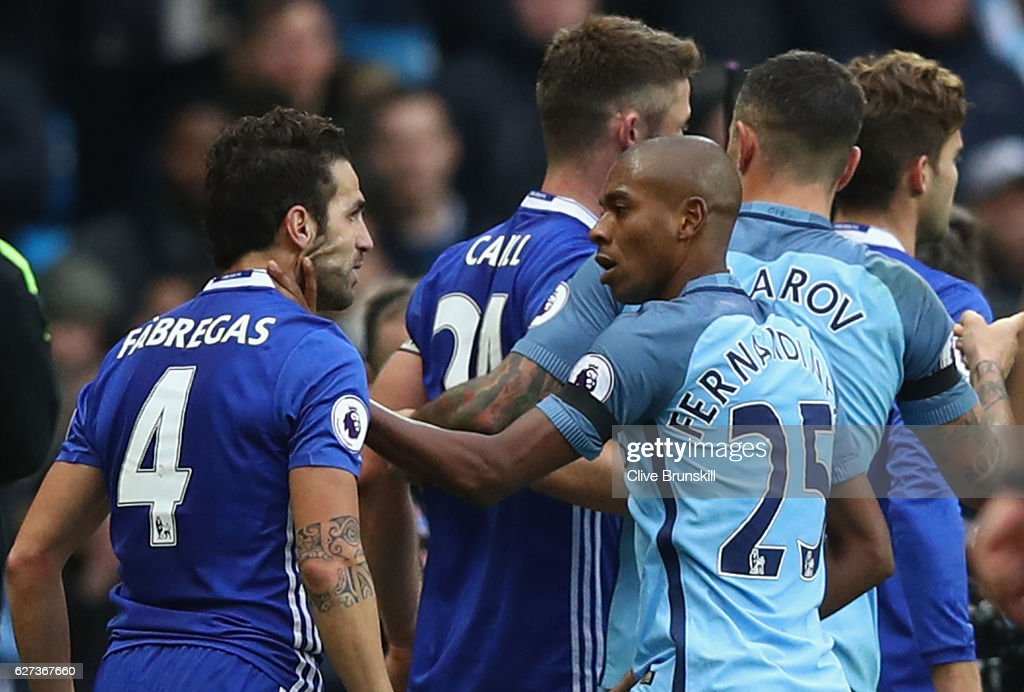Cesc Fabregas of Chelsea and Fernandinho of Manchester City clash during the Premier League match between Manchester City and Chelsea at Etihad Stadium on December 3, 2016 in Manchester, England.